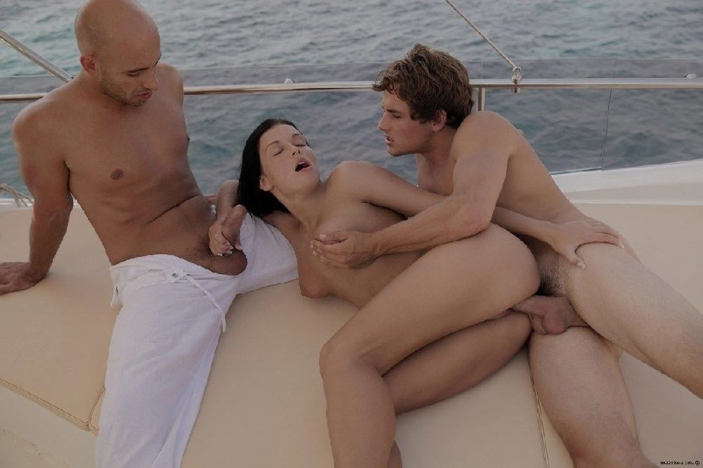 Teen hotties get naked and fucking on a speed boat